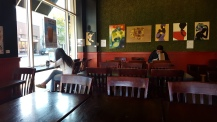A few students get in last minute studying in the open table section of J.P. Licks.