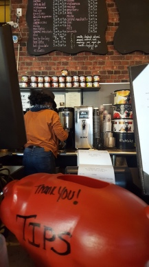 An employee starts working on a customer's latte. Most see J.P. Licks as just an ice cream shop, but it has a wide variety of coffees, as well as monthly blends.